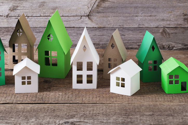 paper houses on wooden background
