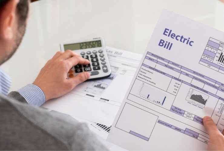 Man calculating his electric bill.