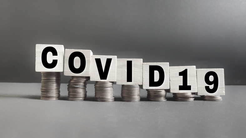 Illustration of down economy: Stacks of coins getting smaller because of COVID-19