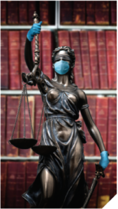Statue of justice with gloves and mask during pandemic