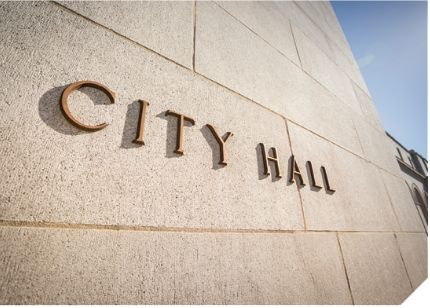 "The words ""City Hall"" on a building"