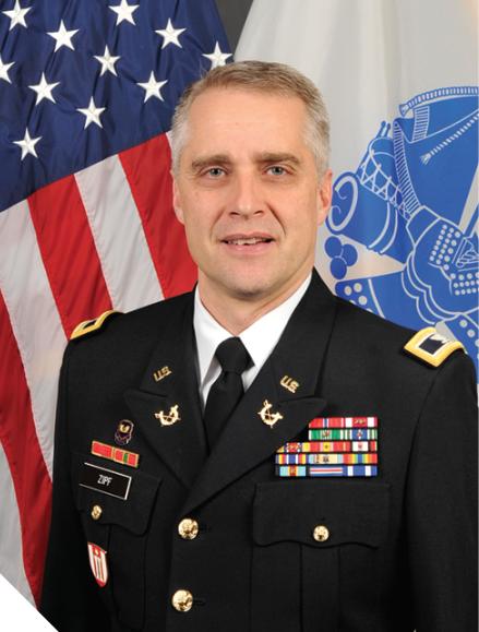 League of Minnesota Cities Defense Litigation Supervisor Ryan Zipf in uniform