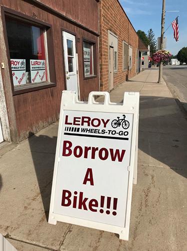 "Sidewalk sign that reads ""Borrow a Bike"""