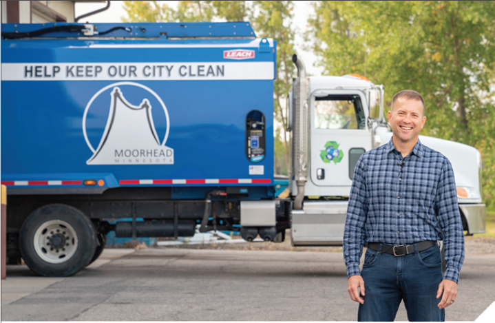 Moorhead Public Works Director Steve Moore stands in front of a recycling truck.