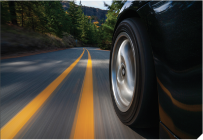 Car wheel on a paved road