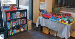 The puzzle exchange table and shelves full of puzzles.