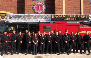 A group of Eagan firefighters in front of a fire truck.